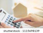 woman accountant or bank worker ... | Shutterstock . vector #1115698139