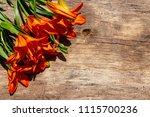 Orange Lilies On Rustic Wooden...