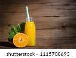 fresh orange juice in bottle... | Shutterstock . vector #1115708693