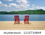 two muskoka chairs sitting on a ... | Shutterstock . vector #1115714849