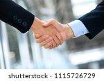 shaking hands of businessmen... | Shutterstock . vector #1115726729