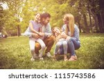 happy young family playing... | Shutterstock . vector #1115743586