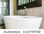 beautiful luxury white bathtub... | Shutterstock . vector #1115755760
