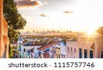 The colonial buildings of Olinda contrasting with the contemporary ones of Recife in Pernambuco, Brazil at sunset.