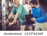 senior man at gym working... | Shutterstock . vector #1115762369