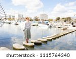 rear view of young woman... | Shutterstock . vector #1115764340