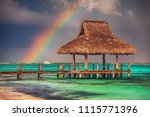 Rainbow Over The  Wooden Water...
