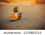 yellow toy bus rides on... | Shutterstock . vector #1115801213