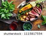 slices beef steak served in... | Shutterstock . vector #1115817554