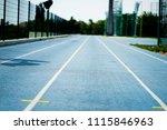 blue racetrack on stadium | Shutterstock . vector #1115846963