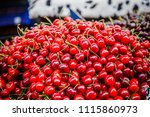 fresh cherries in box at a... | Shutterstock . vector #1115860973