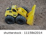 Toy Plastic In The Sand. Digge...