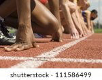female athletes at starting line | Shutterstock . vector #111586499