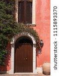 beautiful door decorated with... | Shutterstock . vector #1115893370