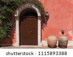 beautiful door decorated with... | Shutterstock . vector #1115893388