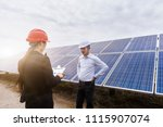 a developer and his assistant... | Shutterstock . vector #1115907074