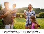 winemaker family together in... | Shutterstock . vector #1115910959
