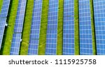solar panels in aerial view | Shutterstock . vector #1115925758