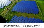 solar panels in aerial view | Shutterstock . vector #1115925944