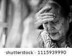 Stock photo black and white image of s or s asian elderly woman facepalm or cover her face by her hands 1115939990