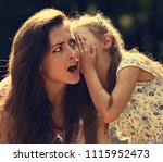 happy kid girl whispering the... | Shutterstock . vector #1115952473