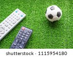 remote control tv and soccer... | Shutterstock . vector #1115954180