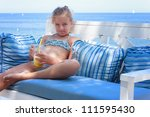 Girl sitting by the sea - stock photo