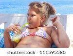Girl drinking juice by the sea - stock photo