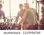 senior man at gym taking weight ... | Shutterstock . vector #1115956769