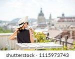 Woman Enjoying Great Cityscape...