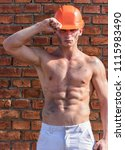 builder with muscular torso and ... | Shutterstock . vector #1115983490