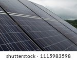 photovoltaic panels on a cloudy ... | Shutterstock . vector #1115983598