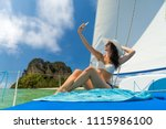 woman on board of sailing yacht ... | Shutterstock . vector #1115986100