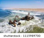 ship wreck along the skeleton... | Shutterstock . vector #1115989700