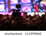 hall with fans shoots video on... | Shutterstock . vector #111599060