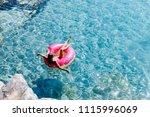 pretty woman lying on floating... | Shutterstock . vector #1115996069
