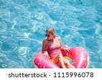 pretty woman lying on floating... | Shutterstock . vector #1115996078
