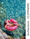 pretty woman lying on floating... | Shutterstock . vector #1115996090