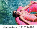 pretty woman lying on floating... | Shutterstock . vector #1115996180