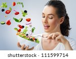 a beautiful girl eating healthy ... | Shutterstock . vector #111599714