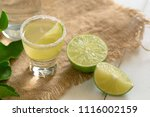 glass the vodka and squeeze the ... | Shutterstock . vector #1116002159