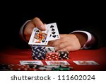 man holding poker cards on red... | Shutterstock . vector #111602024