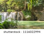 waterfall in a forest on the... | Shutterstock . vector #1116022994