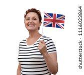 uk flag. woman holding flag of...   Shutterstock . vector #1116023864