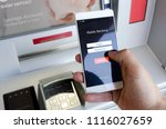 withdraw money from an atm... | Shutterstock . vector #1116027659