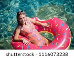 pretty woman lying on floating... | Shutterstock . vector #1116073238