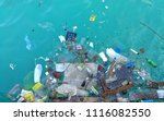 garbage in the ocean sea  | Shutterstock . vector #1116082550