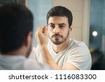 latino person with beard... | Shutterstock . vector #1116083300