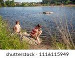 children play near the pond.... | Shutterstock . vector #1116115949
