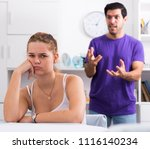 frustrated girl sitting at home ... | Shutterstock . vector #1116140234